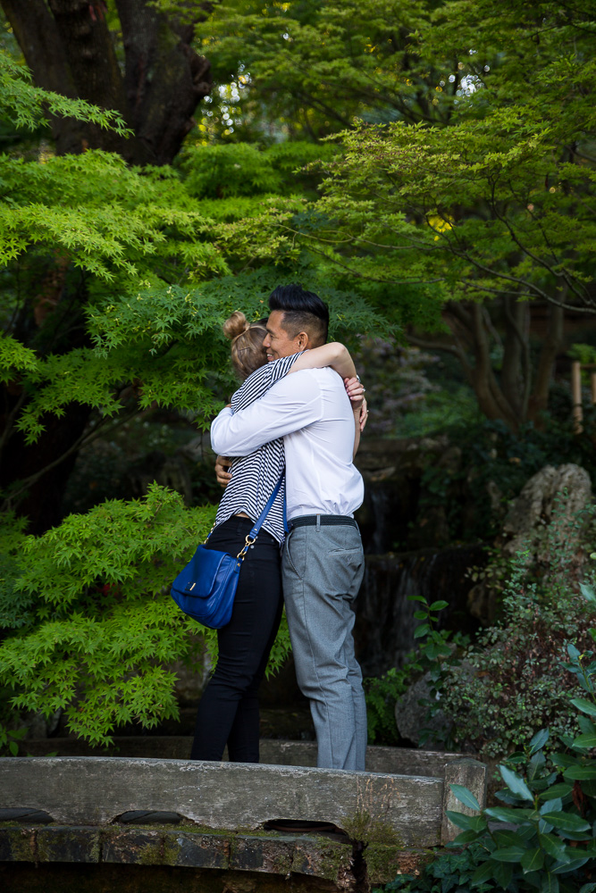 Engaged together in a beautiful botanic garden in Rome Italy.