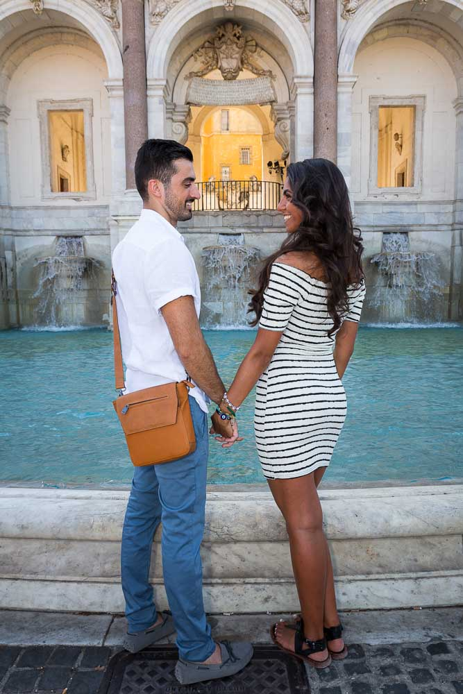 Couple posing during a photo shoot at the Gianicolo water fountain