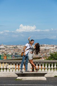Showing the engagement ring to the sky during a photography session in Rome Italy