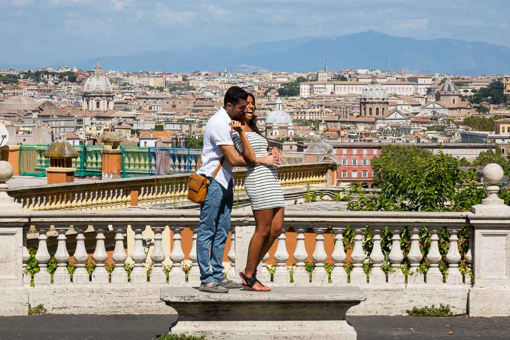 Posing overlooking the city of Rome during a photographer session