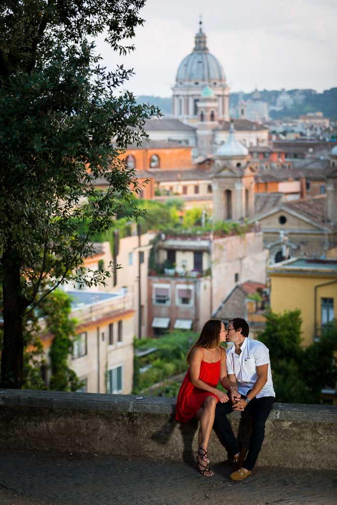 Romantic session overlooking the roman skyline at dusk