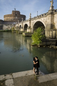 Couple engagement session photos from above by the Tiber river and Castel Sant'Angelo in Rome
