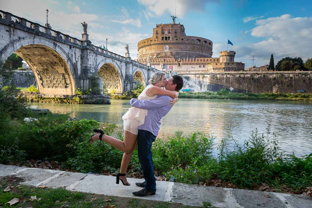 Jumping for joy at the Castel Sant'Angelo Tiber river bank in Rome Italy