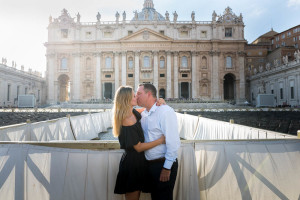 Engagement session kiss at the base of the Vatican's cathedral