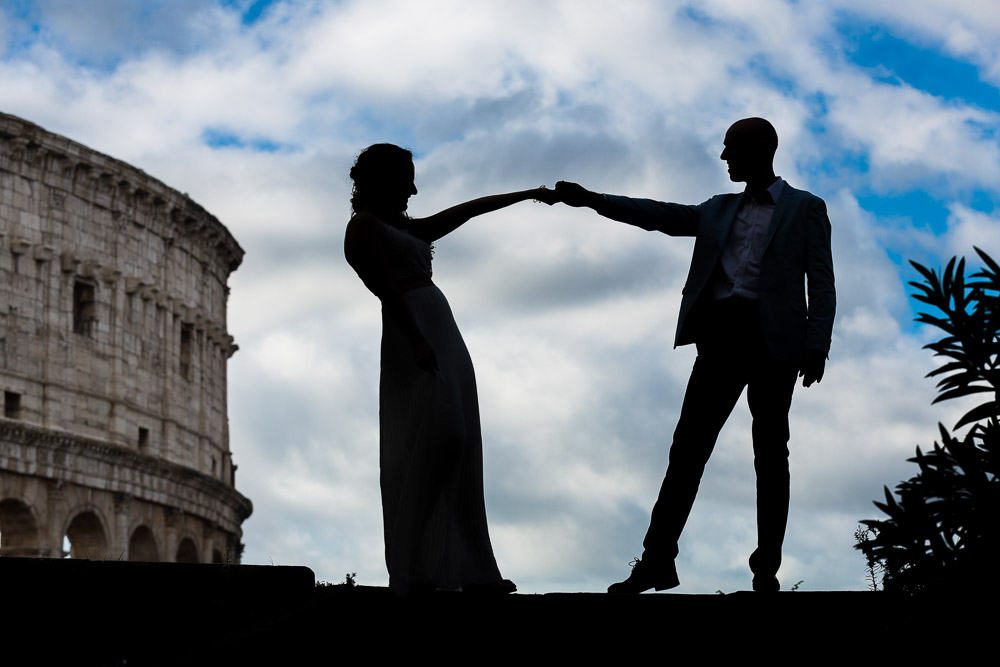 Silhouette image of a couple photographed at the Roman Colosseum during their wedding photos in Rome