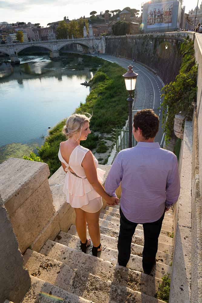 Hand in hand looking at the Tiber river