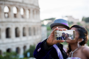 Image taken of the mobile screen while romantically kissing with the Colosseum in the background