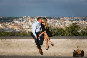 Kissing in front of the roman city at sunset