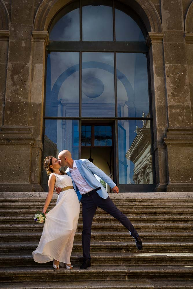 Kissing on the stairs of Piazza del Campidoglio before getting married