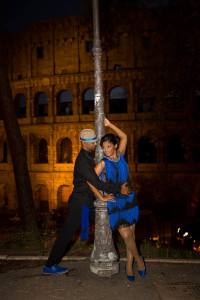 Night time photo e-session of a couple at the Roman Coliseum. Rome, Italy.