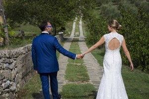 Newlywed couple walking together holding hand in hand