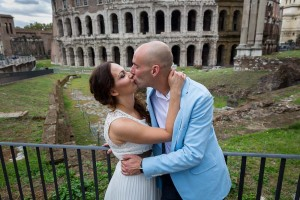Romantically kissing in front of Teatro Marcello