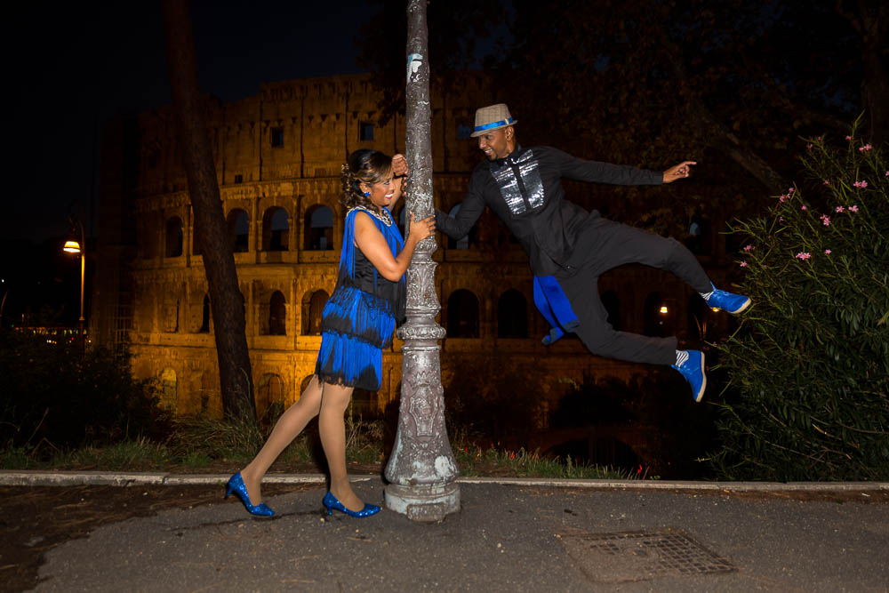 Jumping up in the air photo shoot night time session at the Colosseum in Rome