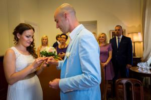 Bride and groom exchange the wedding rings