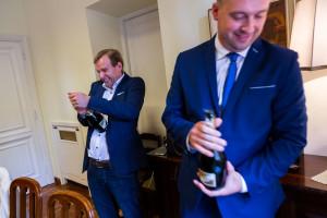 Popping open bottles of champagne