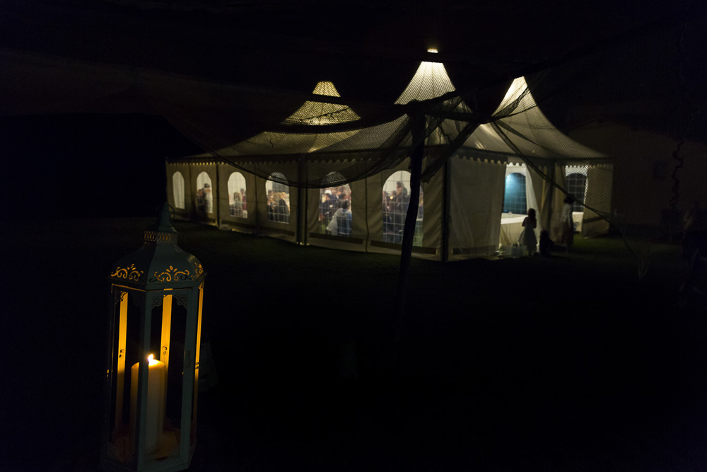 Night time view of the dinner tent lit up in the dark