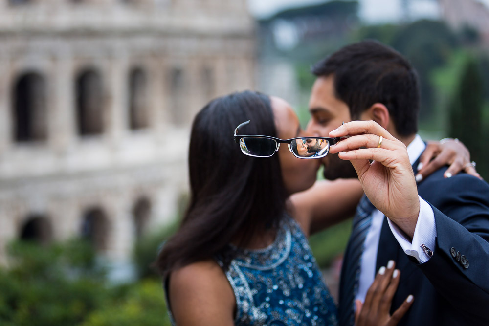 Newlywed image seen through eye glasses at the Colosseum in Rome Italy
