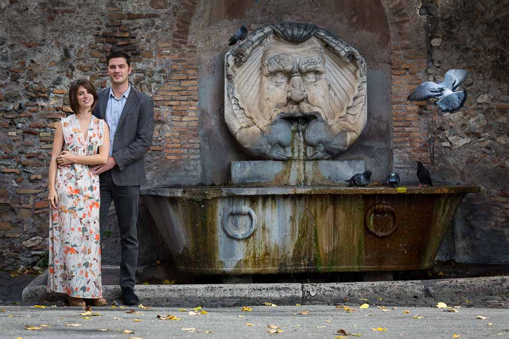 Portrait e-session picture in front of water fountain