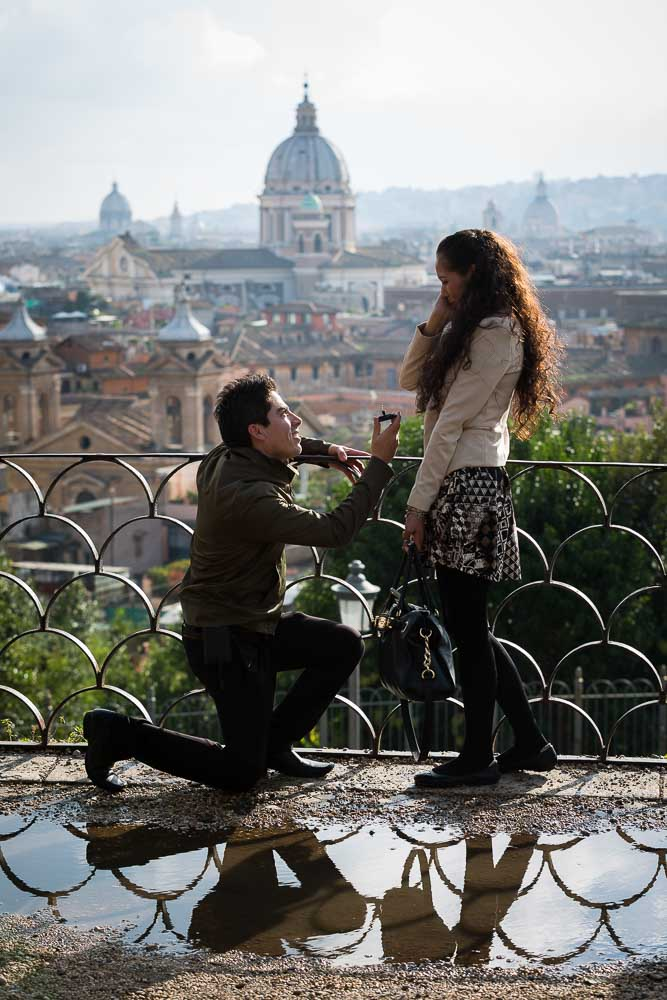 Man proposing to girlfriend at Parco del Pincio overlooking the roman view
