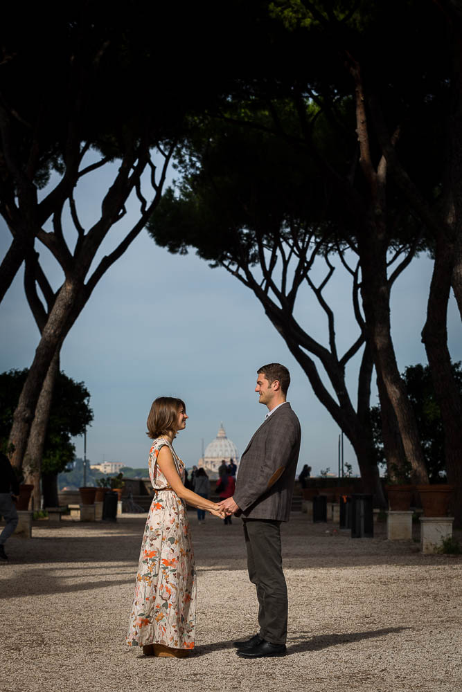 Holding hands together during an engagement session at Giardino degli Aranci