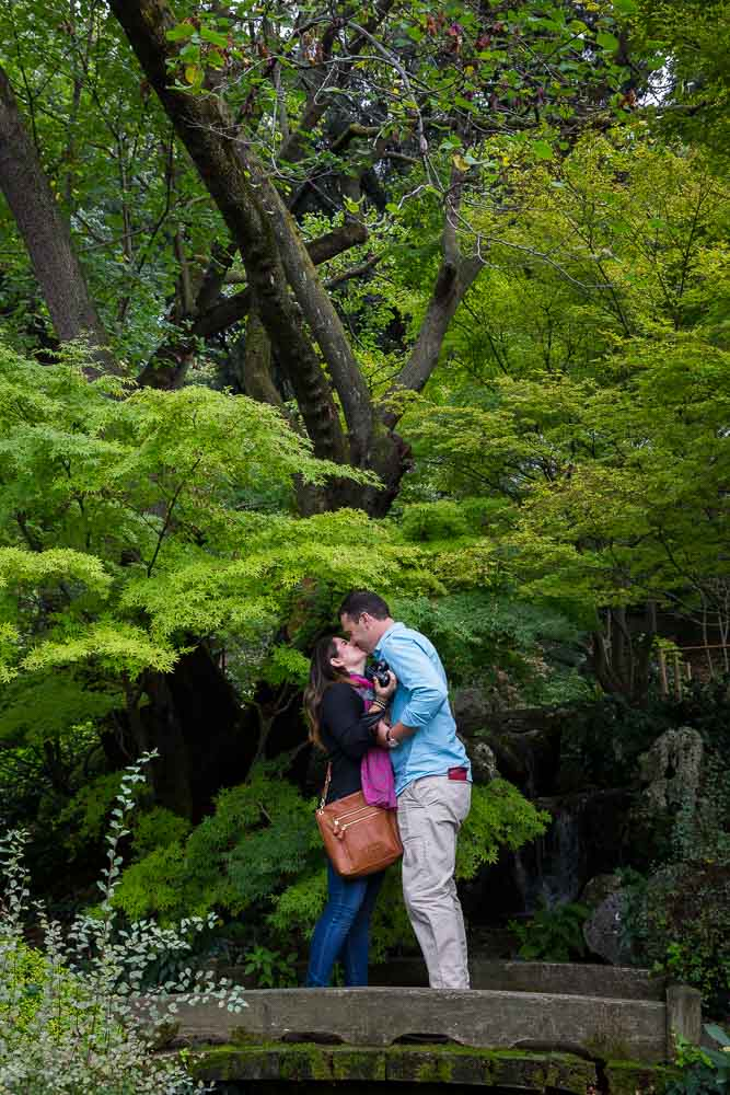 Kissing after marriage proposal in the Japanese Garden of the Rome Botanical garden
