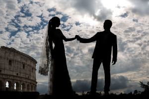 Holding hand in hand silhouette at the Roman Colosseum