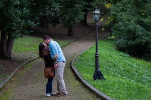 Engagement session kissing on the path