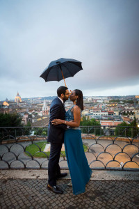 Couple holding an umbrella at Parco del Pincio during a rainy day in Rome