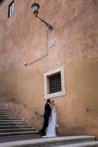 Romantic image of a wedding couple in love in Rome Italy