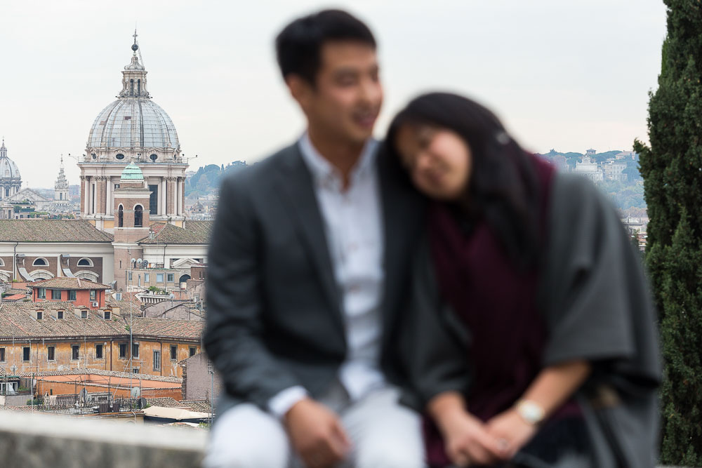 In and out of focus image of a couple romantically in love in Rome Italy