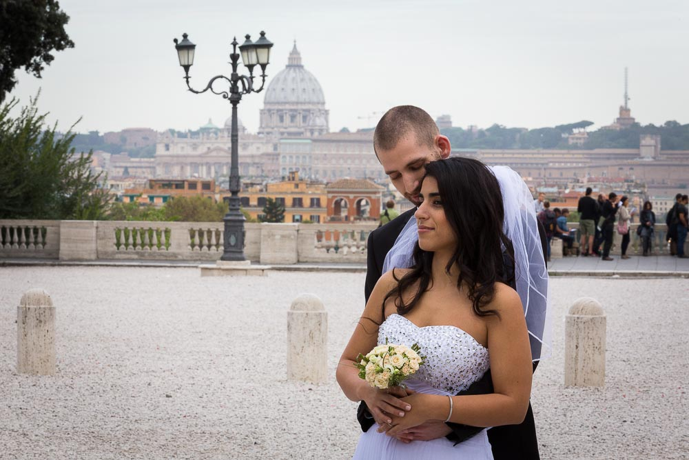 Portrait picture of bride and groom together before the roman scenery