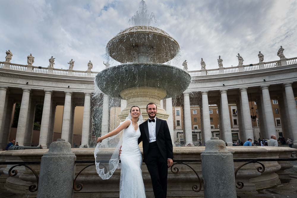 Posing in front of the fountain in San Pietro