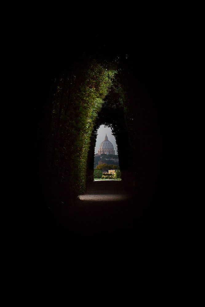 The keyhole view of Saint Peter's dome from the Cavalieri di Malta door in Rome Italy