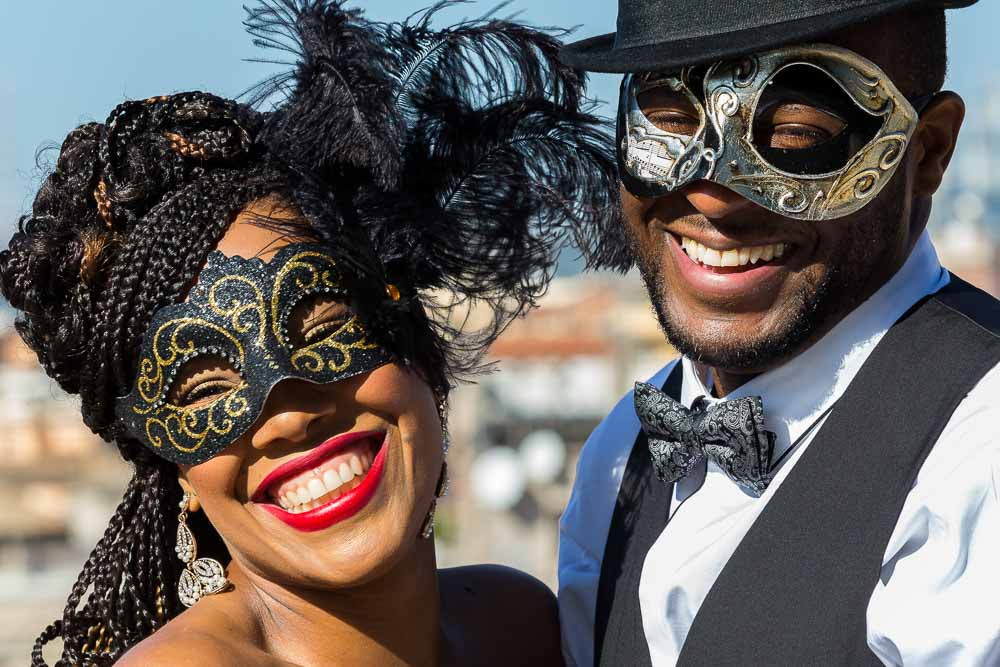 Venetian mask portraits. Close up images. Smiling and laughing.