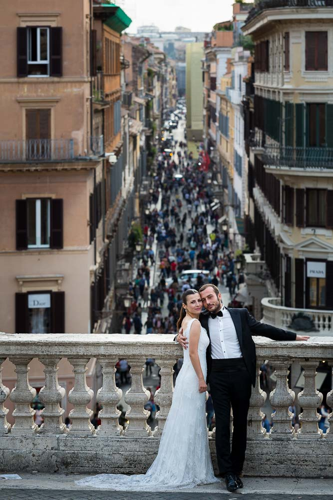Portrait image of newlywed couple on the terrace of Trinita' dei Monti