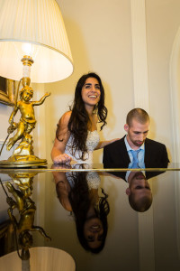 Bride and groom playing the piano together