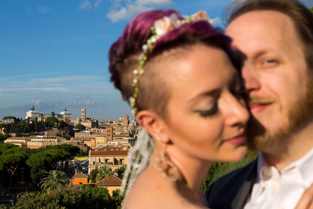 Married couple close up portrait overlooking the city of Rome Italy