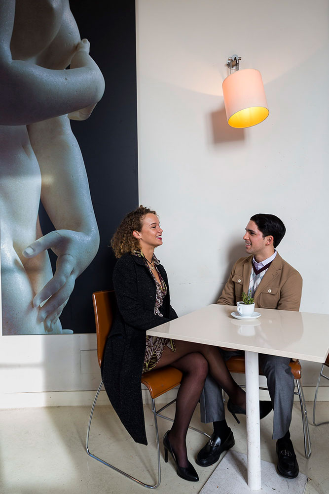 Chatting inside an indoor caffe' during a photo shoot
