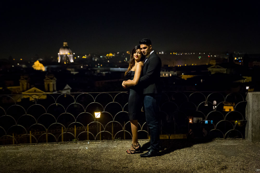 Eengagement session taking place on a terrace overlooking the roman skyline later evening