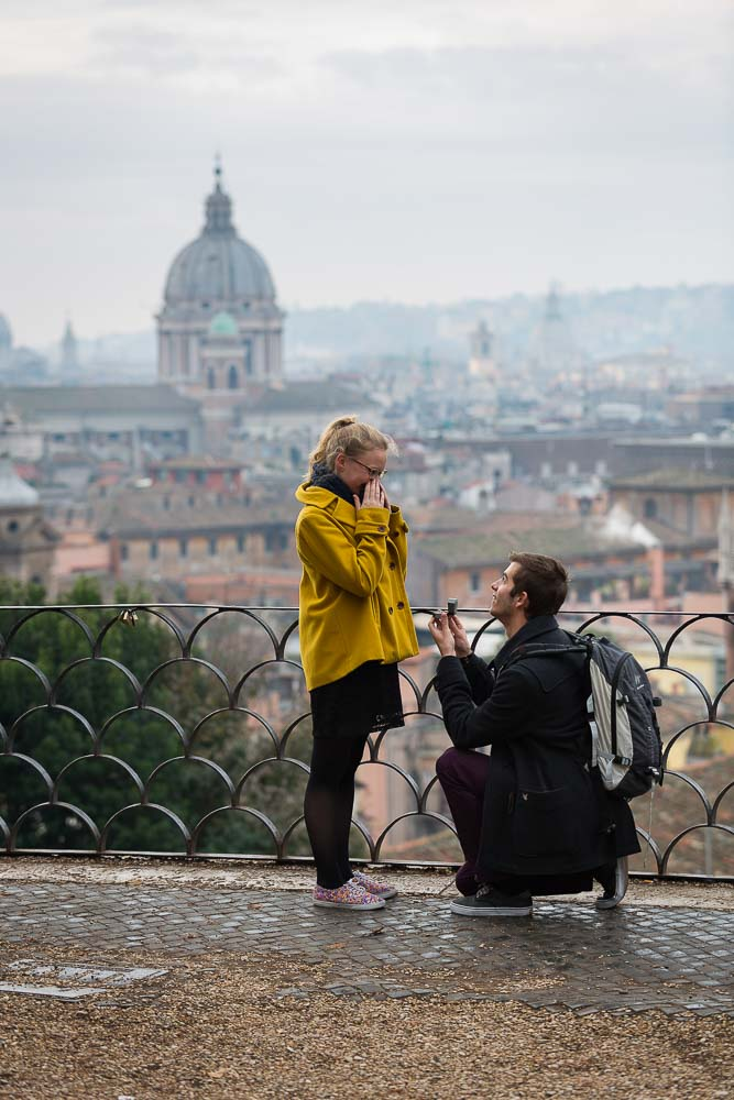 Man proposing at a Park in the city of Rome before the sweeping view. Marriage Proposal Photos.