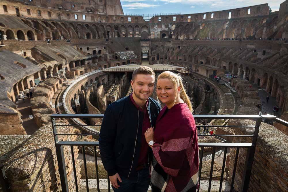 Portrait picture of a couple inside the Coliseum