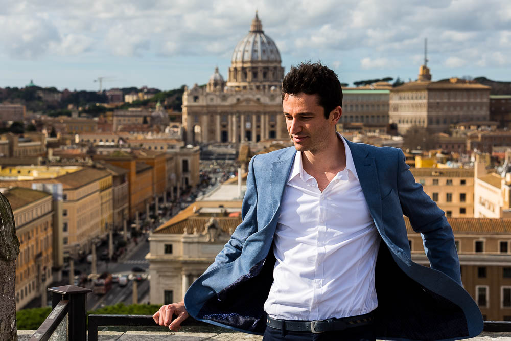 Portrait picture with Saint Peter's dome in the far distance. Spectacular view. Model Photo Shoot in Rome.