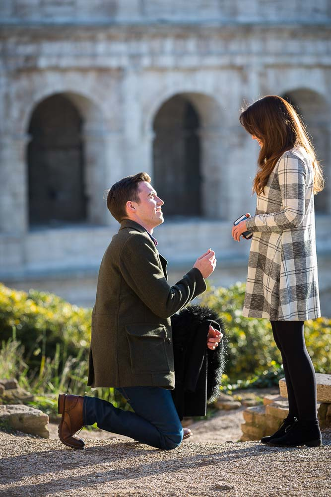 Proposing at the Roman Colosseum Rome hidden marriage proposal photography