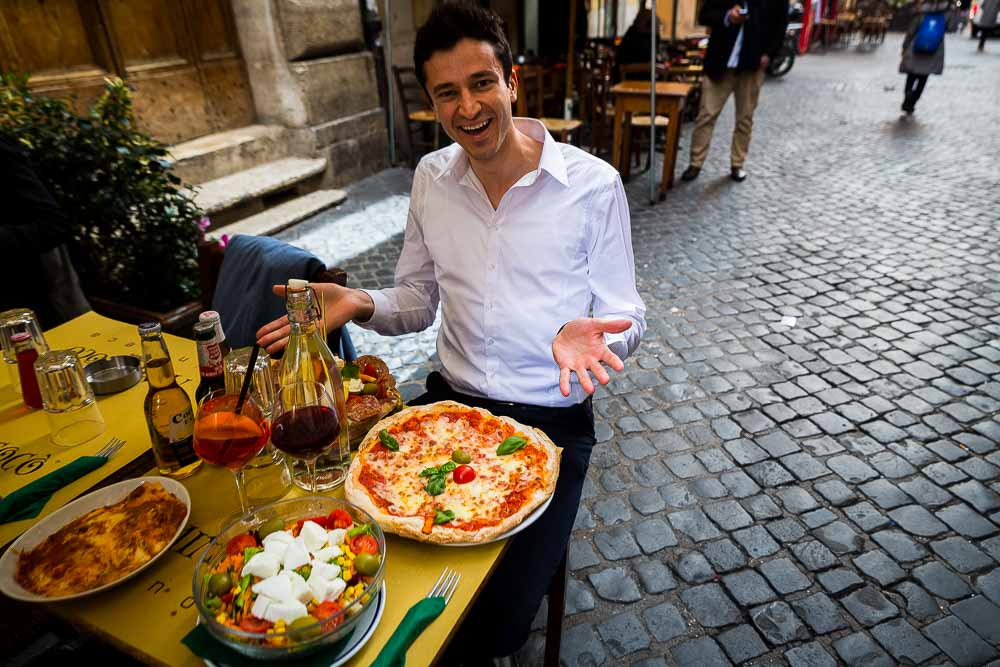 Man eating an Italian pizza in the streets of Rome