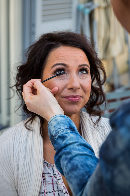Woman getting ready for the big day with the make up preparation