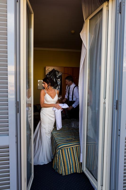 Bride through the window portrait