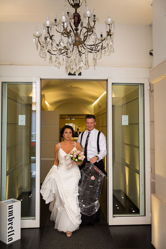 Bride and groom exiting the hotel
