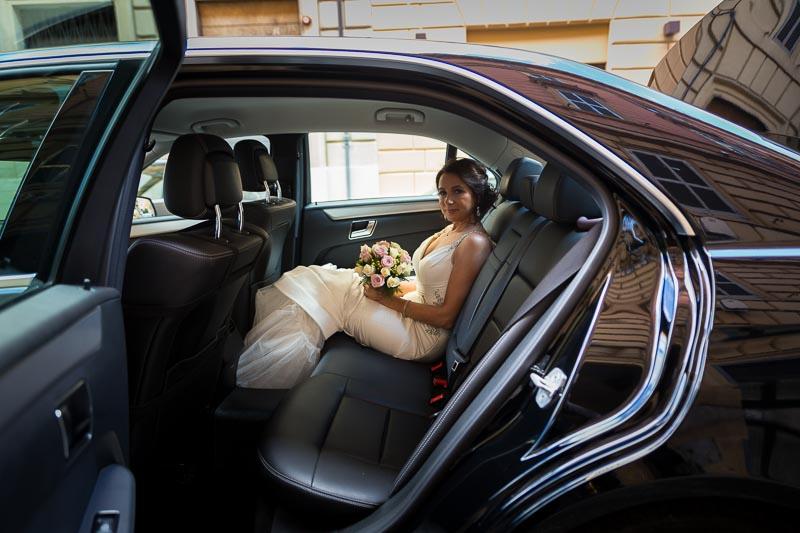 Bride sitting the wedding car