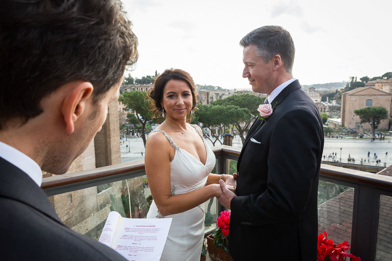 Wedding celebrant reciting the promises overlooking the city. On a Wedding Day in Rome.