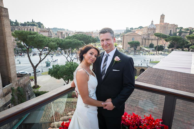Groom and bride portrait overlooking the city of Rome after their private marriage